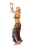 Bellydance. Tanned girl in oriental costume dancing bellydance Royalty Free Stock Photos
