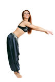 Bellydancer. Smiling red-headed bellydancer in costume bending frontwards Royalty Free Stock Photography