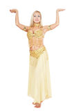 Bellydancer. Beautiful blond bellydancer posing in golden-yellow costume Stock Photos