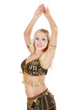 Bellydancer. Beautiful blondie in golden-black bellydance costume posing with hands up Royalty Free Stock Images