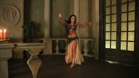 Bellydancer with candles and in beautiful clothes stock video footage