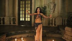 Bellydancer with candles and in beautiful clothes stock footage