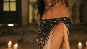 Bellydancer with candles and in beautiful clothes stock video