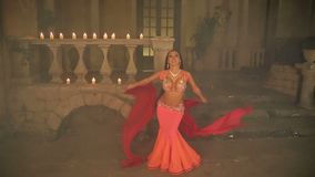Bellydancer with candles in red dress stock video footage