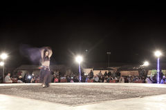 A bellydancer dancing in front of crowd Royalty Free Stock Image