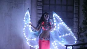 Bellydancer with led light butterfly stock video