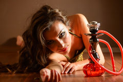 Bellydancer posing with hookah Royalty Free Stock Photo