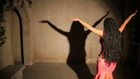 Bellydancer in red dress with shadow stock video