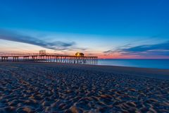 Belmar pier before sunrise, New jersey. A beautiful view of the Belmar pier before sunrise, Belmar, New jersey stock photography