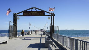 Belmont Pier. The entrance to Belmont Veterans Memorial Pier installed with metal gate and it opens 8:00 m to 9:00pm Royalty Free Stock Images