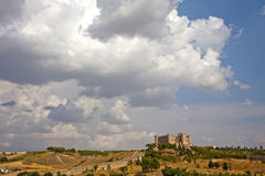 Belmonte Castle Panoramic. It is a 15th century Gothic-Mudejar style castle, designed by master Hanequin of Brussels. It was built on San Cristobal hill, set Stock Photo