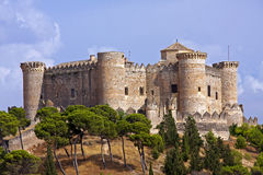 Belmonte Castle. It is a 15th century Gothic-Mudejar style castle, designed by master Hanequin of Brussels. It was built on San Cristobal hill, set over one Stock Photography