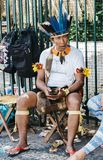 Brazilian indigenous man on his cell phone. Belo Horizonte, Brazil - Dec 24: 2017: Brazilian indigenous Tupi and Tapuia man dressed in a traditional costume Royalty Free Stock Photography