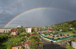 Beautiful rainbow over the resort city of Belokurikha in the Altai Krai. Belokurikha, Russia - July 30, 2015: Beautiful rainbow over the resort city of Stock Photos
