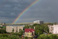 Beautiful rainbow over the resort city of Belokurikha in the Altai Krai. Belokurikha, Russia - July 30, 2015: Beautiful rainbow over the resort city of Royalty Free Stock Image
