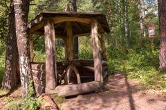 Beautiful wooden arbor on the terrenkur health trail along the Belokurikha mountain river. Belokurikha, Russia - July 30, 2015: Beautiful wooden arbor on the Royalty Free Stock Image