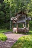 Old mill on terrenkur health trail along the Belokurikha mountain river. Belokurikha, Russia - July 30, 2015: Old mill on terrenkur health trail along the Stock Image