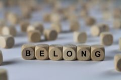 Belong - cube with letters, sign with wooden cubes Stock Photo
