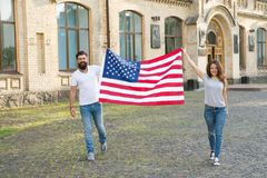 Belonging to american nation. Happy citizens celebrating Independence day. American citizens holding national flag stock images