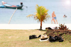 Belongings on the lawn with tourist activities on the beach Stock Photo