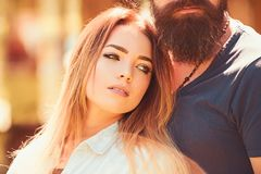 She belongs to him. Sensual woman with long hair and makeup look. woman and bearded man in love relations. Couple. She belongs to him. Sensual women with long stock photo