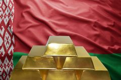 Belorussian gold reserves. Shining golden bullions on the  belorussian flag background Royalty Free Stock Photos