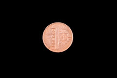 Belorussian one kopeck coin on black. Belorussian one kopeck coin close up on a black background Stock Images