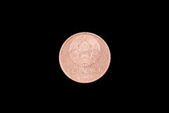 Belorussian one kopeck coin on black. Belorussian one kopeck coin close up on a black background Royalty Free Stock Images