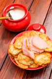 Belorussian traditional cuisine. Potato pancakes with meat and sour cream Stock Photos