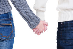 Beloved couple holding hands. Against white background Stock Photography