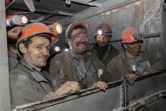 BELOVO, RUSSIA JULY 17, 2015: Miners are directed to the shift in the mine on the bus. Miners are directed to the shift in the mine on the bus Royalty Free Stock Photos