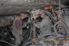 BELOVO, RUSSIA JULY 17, 2015: Miners perform installation of structures below ground in the mine Stock Images