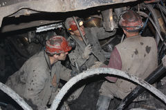 BELOVO, RUSSIA JULY 17, 2015: Miners perform installation of structures below ground in the mine Royalty Free Stock Image