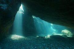 Below rocks underwater sunbeam Mediterranean sea. Below big rocks underwater with sunbeam from hole, Mediterranean sea, natural scene, Pyrenees Orientales Stock Images