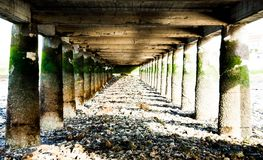 Below the bridge in Alcochete Portugal. Picture taken below the pier in Alcochete Portugal on a sunny day Royalty Free Stock Photography