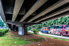 Below the bridge highway with green grass photo taken in jakarta indonesia Stock Photos