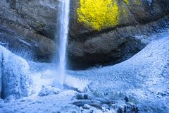 Frozen Latourell Waterfall in the Columbia River Gorge. Below freezing temperatures and cold winds turn spray from Latourell Falls to ice as it coats the stock photography