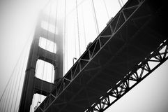 Below the Golden Gate Bridge. Black and white photo of the Golden Gate bridge in the fog shot from below Stock Photo