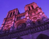 From below majestic Notre Dame cathedral in Paris stock photography