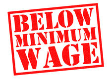 BELOW MINIMUM WAGE. Red Rubber Stamp over a white background Royalty Free Stock Photo