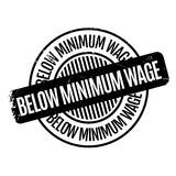 Below Minimum Wage rubber stamp. Grunge design with dust scratches. Effects can be easily removed for a clean, crisp look. Color is easily changed Stock Photo