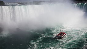 Below Niagara Falls with a tour boat in the mist stock video
