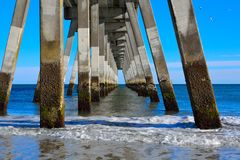 Below Pier. Underneath a pier on the shore Royalty Free Stock Photos