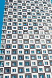 From below shot of modern and new apartment building. Photo of a tall block of flats against a blue sky. Royalty Free Stock Photography