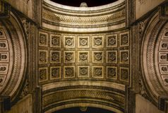 From below Arc de Triumph in Paris. From below shot of ornamental stone dome of Arc de Triumph with amazing architectural decoration Royalty Free Stock Photography