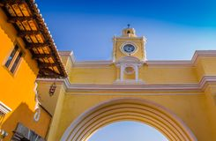 Below view of Santa Catalina arch with a gorgeous blue sky background durig a beautoful sunny day in Antigua city. In Guatemala Royalty Free Stock Photography