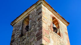 Belry. Well preserved ancient bell tower with sun, shade, under a blue sky Stock Images