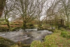 Belstone Bridge, Dartmoor. Belstone is situated up on the North Moor, a quiet village with a thriving community and active events calendar! There's often royalty free stock image