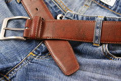 Belt. Blue jeans and a brown leather belt Royalty Free Stock Image