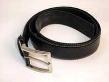Belt. A black elegant belt with a silver buckle Royalty Free Stock Photo